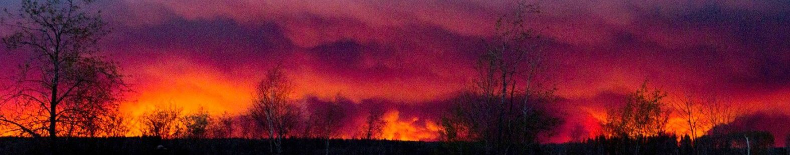 Photo showing Fort McMurray wildfire, filling the horizon with a giant plume of smoke overhead. Did anthropogenic climate change increase the chance of this extreme wildfire?