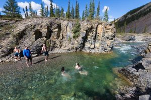 Photo shows a a family swimming in a mountain river, Canada's top ten weather stories 2017 by David Phillips
