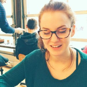 Photo shows a young caucasian woman, wearing glasses. Her hair is pulled back. Samantha Mailhot worked with the Carbon Clock at the Human Impacts Lab.