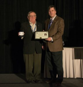 Photo shows two men, one is presenting a CMOS award to the other (Martin Taillefer and Paul André Bolduc.