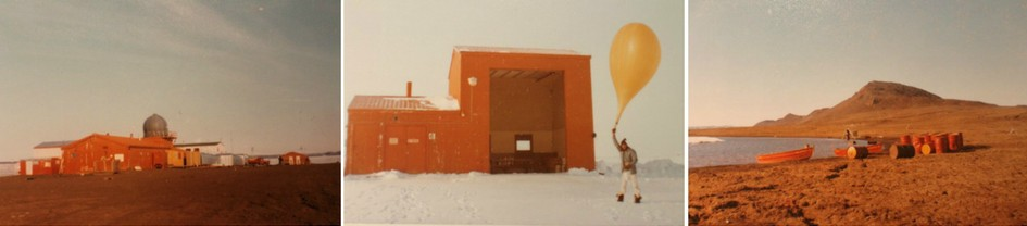 Three colour photographs of Isachsen weather station in the years 1974-75. The first shows the station, a collection of brown buildings, in the full sunshine. The second shows a man holding a large yellow weather balloon, with a building in the rear. The third shows a beach, with a rowboat pulled up to the shore, and a collection of empty barrels lying beside it.