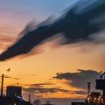 Banner Image for Gilbert's article on the origins of PM2.5 into Quebec shows a sunset skyline with smokestacks