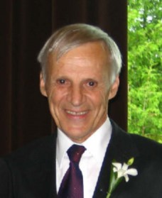 Photo of a smiling older man, with gray hair, Ray Desjardins, CMOS member.