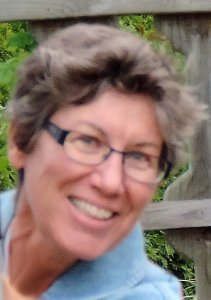 Photo of Rebecca Milo, smiling woman with short hair and glasses, author of women in meteorology