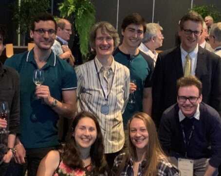 Kimberly Strong, CMOS President, pictured standing with a group of about 6 students at the IUGG General Assembly CMOS Banquet. All smiling and relaxed.