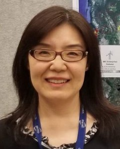Qian Li, Asian woman with shoulder length hair and glasses, smiling