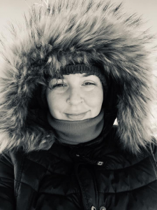 Nicole Renaud, a young Caucasian woman in a parka with a furry hood.