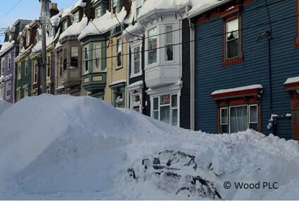 Snowy street with St. John's rowhouses
